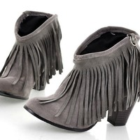 Fringed cowboy boots thick with low cylinder