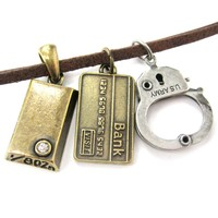 Bank Heist Themed Handcuff Gold Bar Bank Card Charm Necklace | DOTOLY