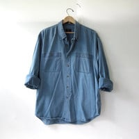 vintage jean shirt. oversized blue denim shirt. button down shirt. denim pocket shirt.