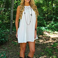 cream colored babydoll dress