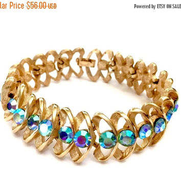 Trifari Mid-Century Link Bracelet, Blue Aurora Borealis Rhinestones, Textured and Smooth Gold Tone Metal, Articulated Links, Designer Signed