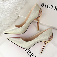 Pointed Toe Heeled Carved Metal Pumps