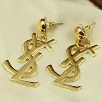 YSL sells fashion accessories with metal letter studs