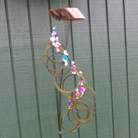 Upcycled wine bottle Wind Chime, Greenish Amber circle Chime, yard art, Garden Decor, Rainbow beads