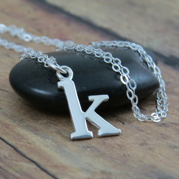 Lowercase initial necklace in sterling silver, typewriter style letters