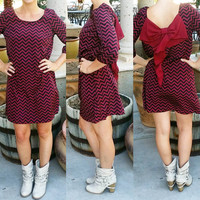 TO THE BEAT BOW BACK CHEVRON DRESS IN WINE/BLACK MULTI