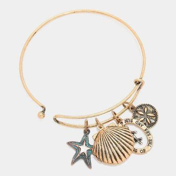 """The Dreaming Of The Sea And Sun"" Shell Locket & Starfish Charm Bracelet"