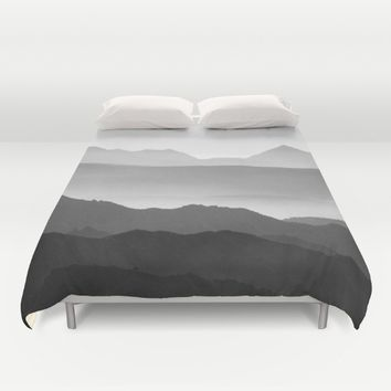 Mountains fog. Sunset Duvet Cover by Guido Montañés