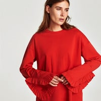 TOP WITH FRILL SLEEVE DETAILS