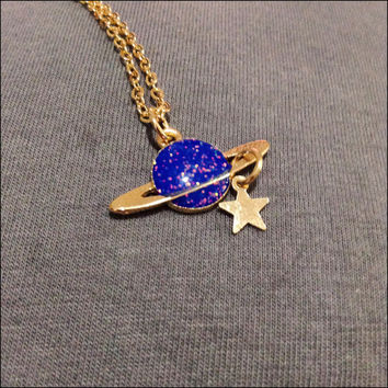 Saturn Necklace with glitter in color purple and gold with star hanging from rings space jewelry sci fi science nerd galaxy charm accessory