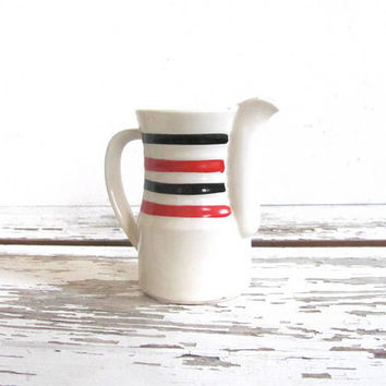simple white creamer with orange and black stripes / pitcher / ceramic vase / made in Czechoslovakia