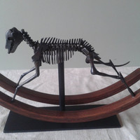 Skeletal steel rocking horse