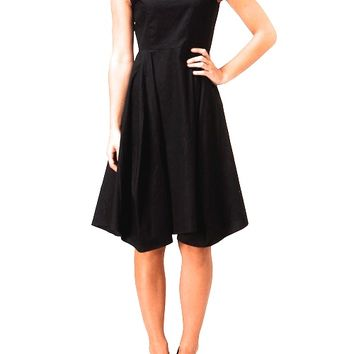 This classic LBD features a boat neckline, fitted and flare structure, asymmetrical bottom hemline, hidden zipper fastener at back with eye hooks closured, slightly high waited seam to a A-line skirt with two side of hidden pockets. Unlined. Pair with Jeff