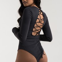 AKIRA Boat Neck Long Sleeve Ribbed Laced Up Snap Closed Open Back Jumpsuit in Slate