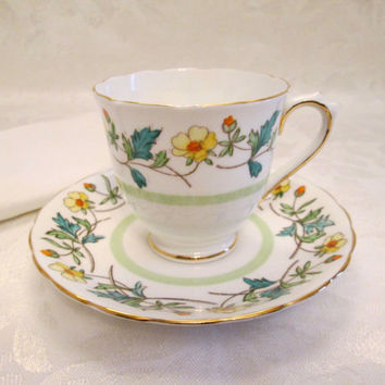 Vintage Tuscan Yellow Floral Green Leaf Tea Cup and Saucer Gold Trim Fine Bone China Made in England