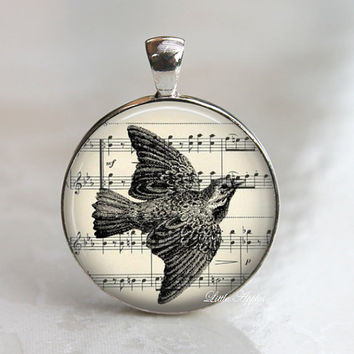 Bird fly glass necklace, music sheet background, inspirational keychain