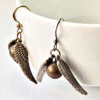 Winged Golden Sphere Dangling Earrings: flying gold ball charm
