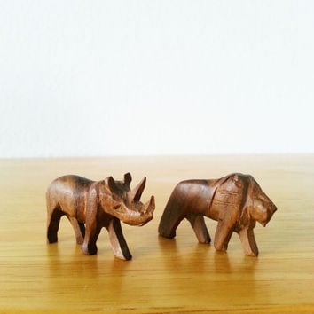 Cool vintage wood carved little lion and rhino animals