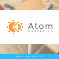 OOAK Premade Logo Design - Orange Atom - Perfect for a makerting agency or a science blog