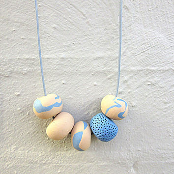 NL-188 Sea Blue and Latte Caramel Swirl Patchy Pattern and Textured Donut-shaped Clay Beads Necklace in Adjustable Light Blue Leather Cord