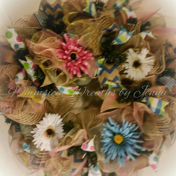 "Spring deco mesh floral door wreath. 30"" and very full. Natural Jute mesh, pink, yellow, blue mesh with colorful ribbons."