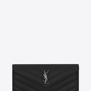 "Large LOULOU wallet with a flap in shiny black leather with ""Y"" quilting"