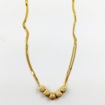 Gold Stardust Floating Bead Necklace