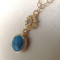 Turquoise Jewelry Gold bezeled turquoise necklace and sunflower cz cubic zirconia necklace dangle from a goldfilled chain