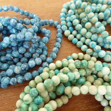 Three dyed stone necklaces in teal, turquoise and green