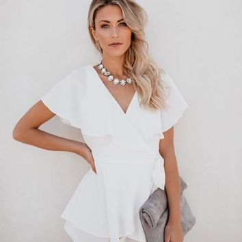 Whimsical In White Wrap Romper