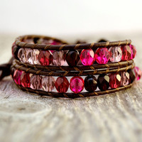 Shades of red wrap bracelet. Faceted Czech glass beads on brown leather