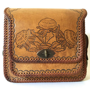 Vintage 1970s mid brown hand tooled leather shoulder bag with Waratah motifs, large front pocket and plaited strap