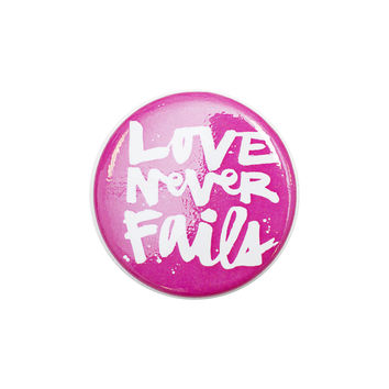Love Never Fails Pink Button