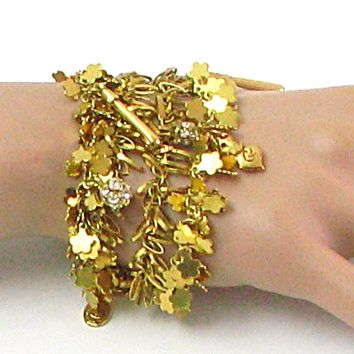 Bracelet CHRISTIAN LACROIX vintage with 4 rows of small gold metal charms