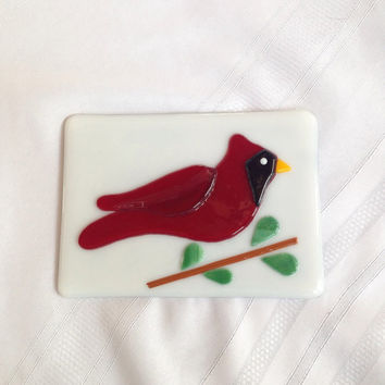 Handcut fused glass cardinal mounted on an easel frame back picture panel