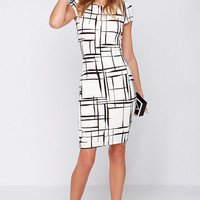 Long and Drawn Out Black and Ivory Print Midi Dress