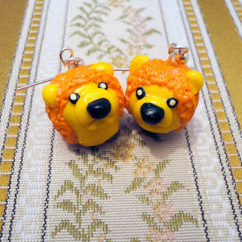 Lion earrings from yellow and orange polymer clay by NellinShoppi