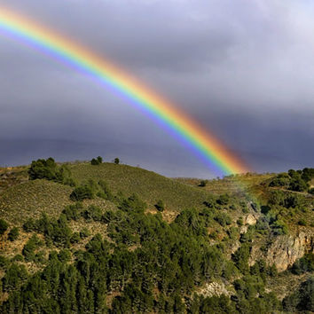 Big rainbow. At he mountains by Guido Montañés