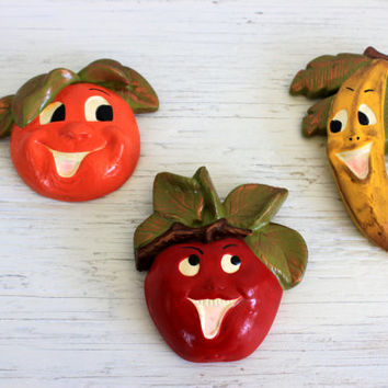 1950s funny fruit faces wall decor // chalkware // plaster ware // apple orange banana // kitschy kitchen