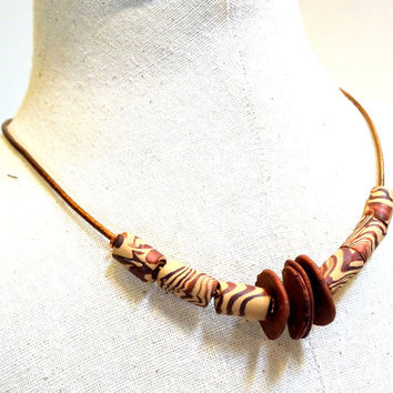 Copper leather necklace with handmade clay animal print beads, organic, rustic, primitive, adjustable length, one of a kind