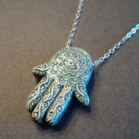 Hamsa hand and evil eye necklace  Raku by blackandwhitejewels
