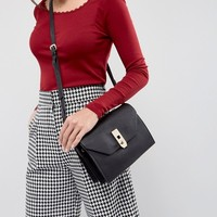 Paul Costelloe Real Leather Black Cross Body Box Bag with Gold Closure at asos.com