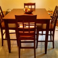 Cherry wood bistro table with four chairs