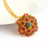 Elegant beadwork pendant in green red and gold colors, sparkling star shaped pendant for everyday use, good gift for the loved one