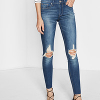 mid rise distressed knee ankle jean legging