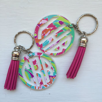 "KEYCHAIN WITH TASSLE - 2"" Lilly Pulitzer-inspired acrylic keychain/ring with suede leather tassle. Can also be used as a bag tag/accessory."