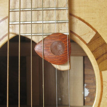 Exotic Lace wood guitar pick with leather friction pads.