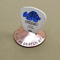 Copper guitar pick stand rocking with music is love in search of a word