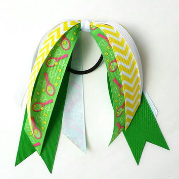 Green and yellow tennis ribbon streamers, tennis hair bow ponytail ribbon, hair streamers, tennis bow, racquet, tennis ball, tennis player