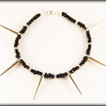 Black spike bracelet - black seed beads, acrylic silver spikes and a magnetic clasp.